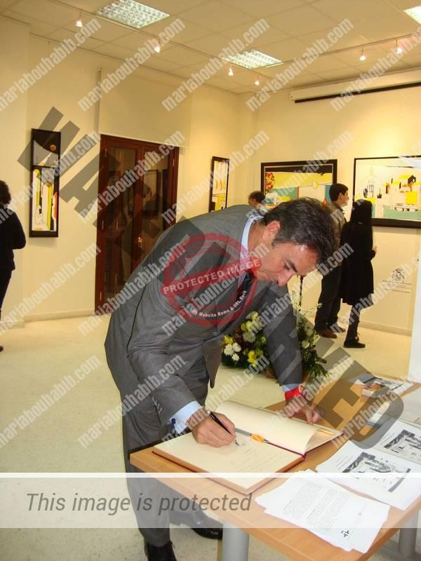 The ambassador Juan-Carlos Gafo signing the book of honor